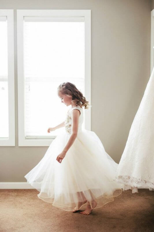 Flower girl excited to twirl in dress