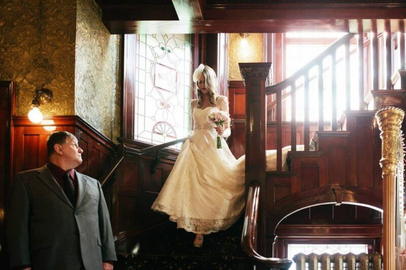 Jen coming down the stairs to the ceremony. In the haunted ballroom.