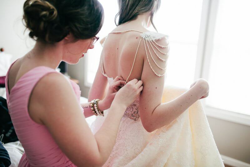 Me making some last minute adjustments to Jen's pearl strap.