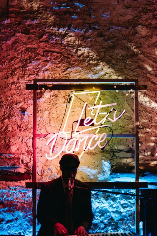 The custom neon Let's Dance sign at Karly and Josh's reception
