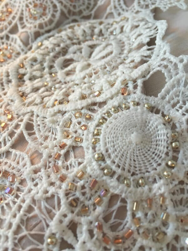 Close-up detail of beading in Jessica's dress.