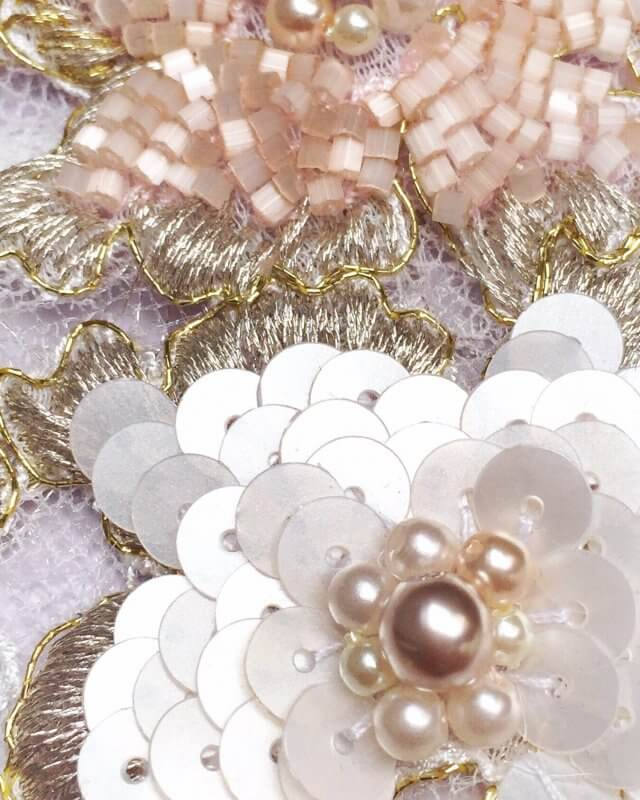 Close-up detail of Karly's beading.