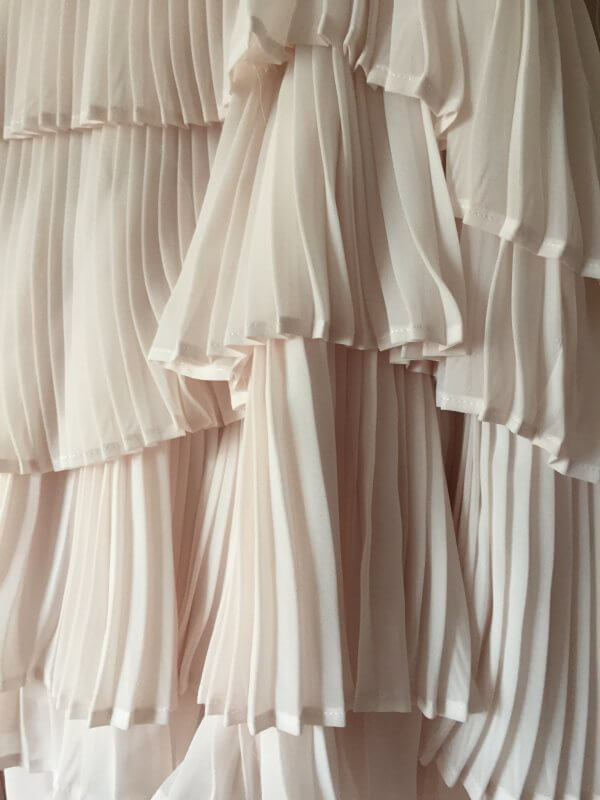 Detail of hand-pleated tiers of chiffon in Karly's skirt.