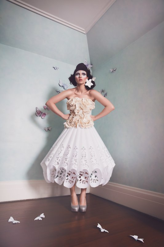 Photo by Shannon Wolf, hand-cut paper gown with LEDS by Christopher Lewis and Breeyn McCarney