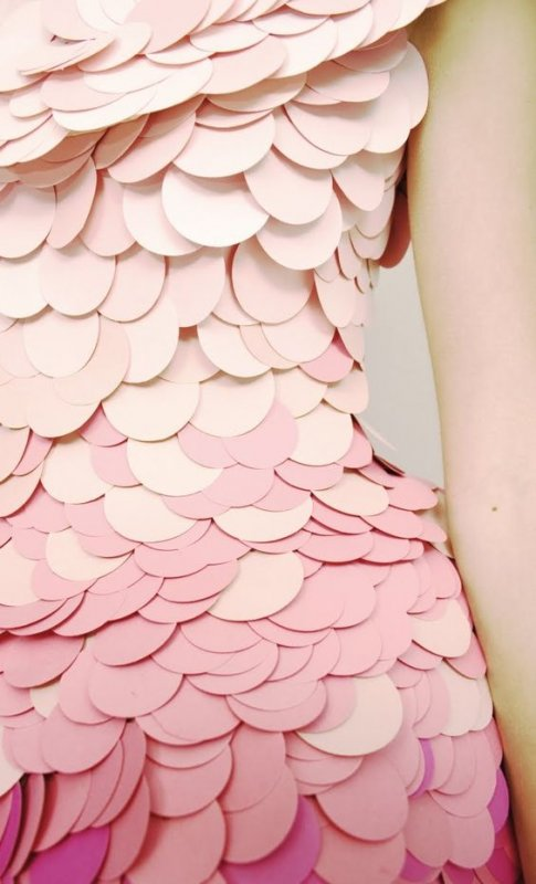 Detail of dress made of giant ombre pink sequins