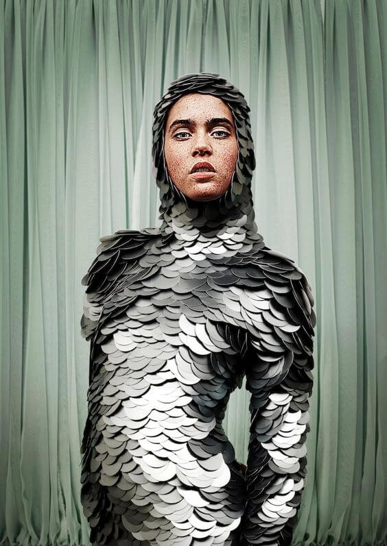 Person wearing giant silver sequin armour