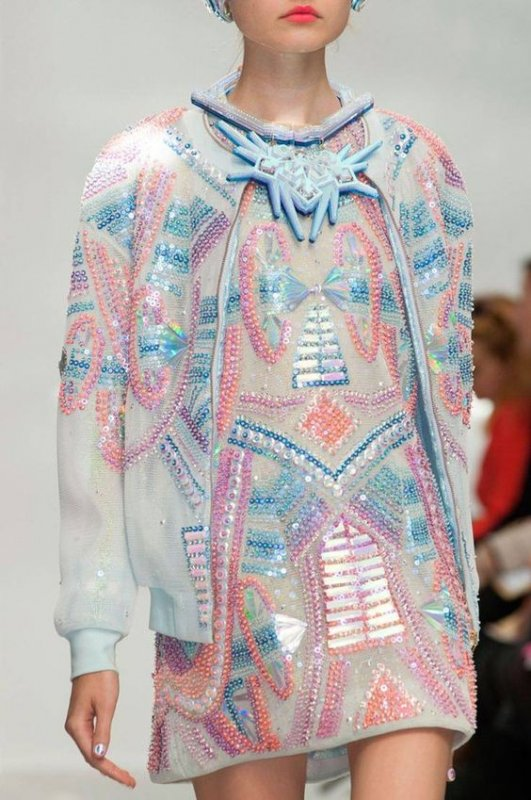 Iridescent sequin patterns on dress and jacket
