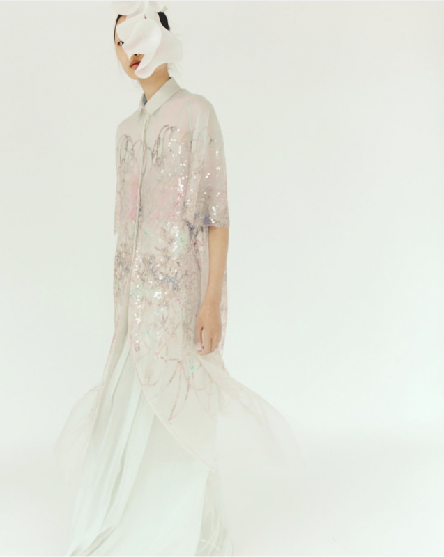 Delicate shirt dress with iridescent sequins cascading down the front