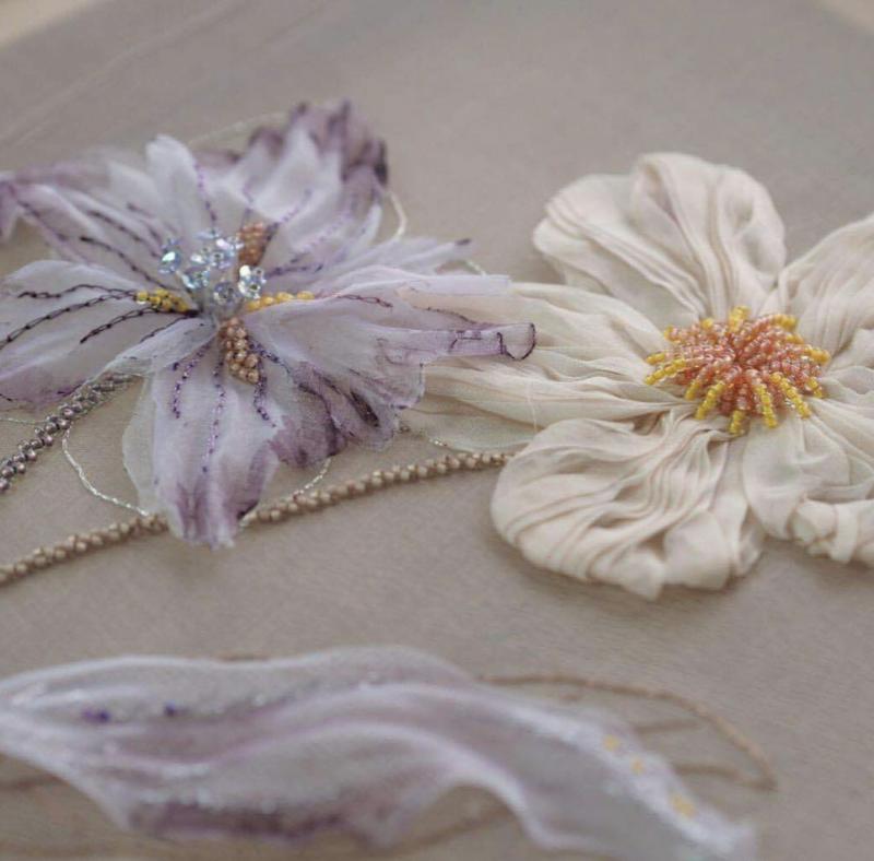 Two flowers embroidered with ribbons