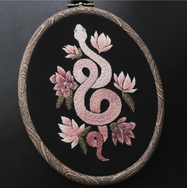 Pink snake embroidered on black